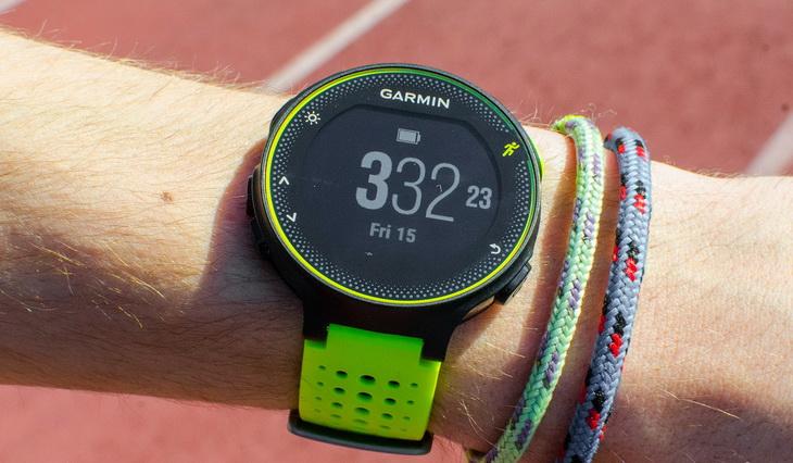 A man's hand wearing a Garmin GPS watch