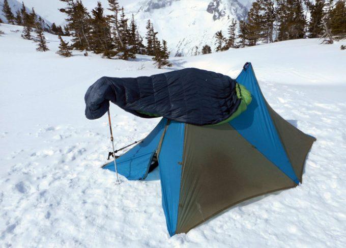 sleeping bag over tent