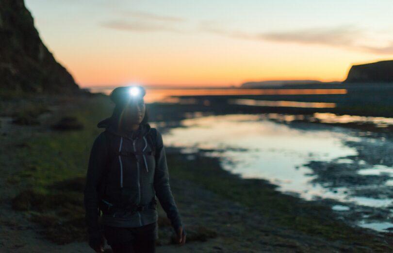 girl wearing headlamp while hiking