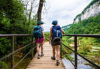 Couple wearing backpacks on a bridge