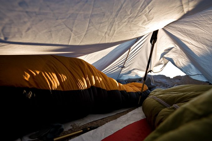 traditional sleeping bag in tent