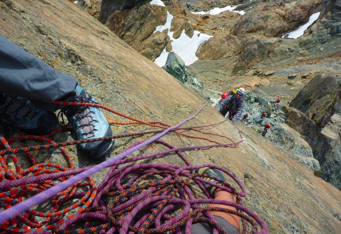 climbers hanging onto ropes