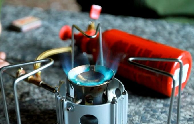 burning backpacking stove with fuel tank