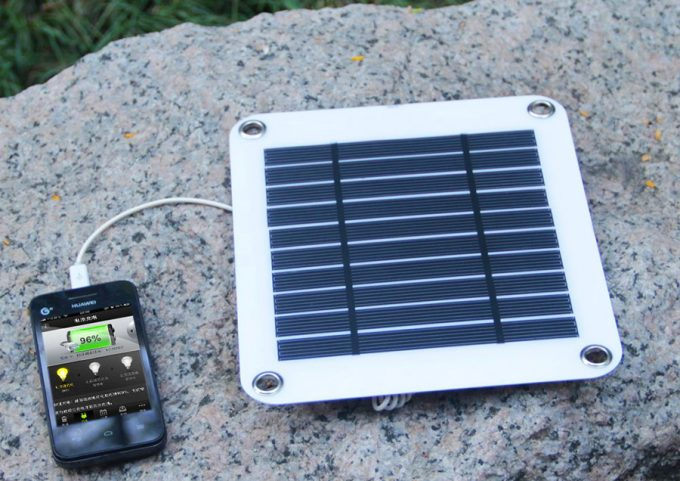 solar panel charging a phone