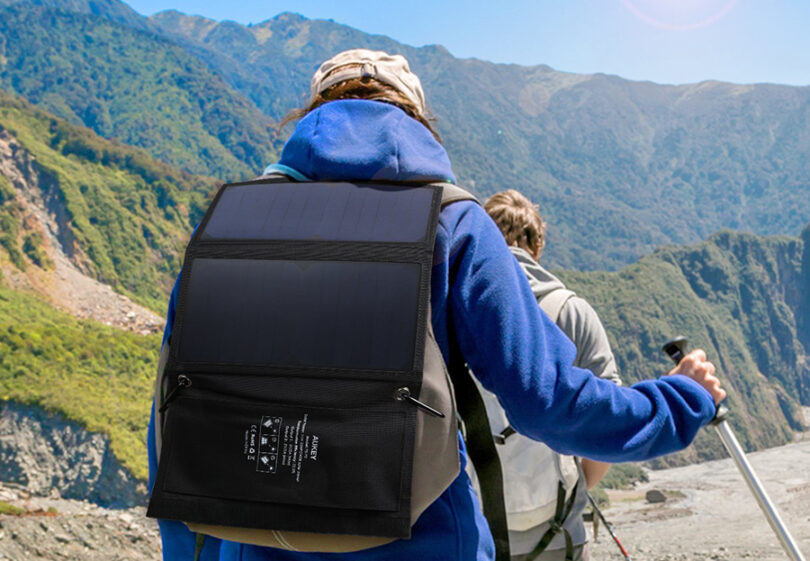 hiker wearing solar charger on back