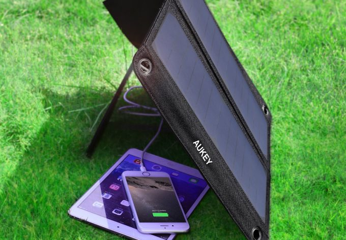 solar charger charging phone and tablet