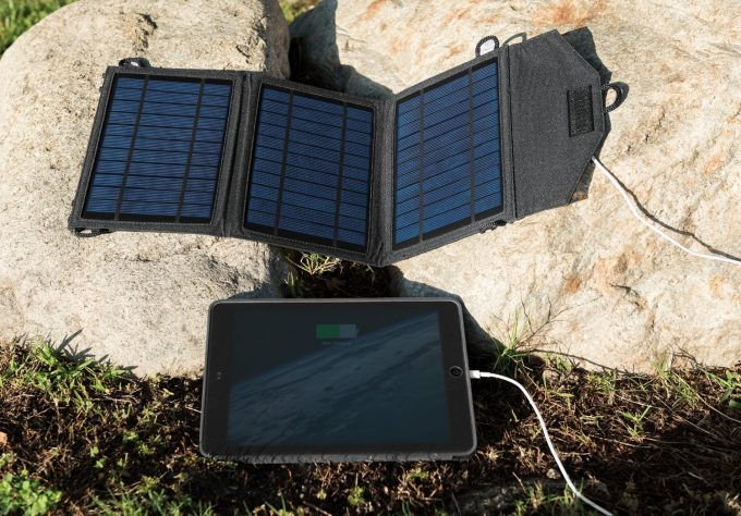 solar charger charging a tablet