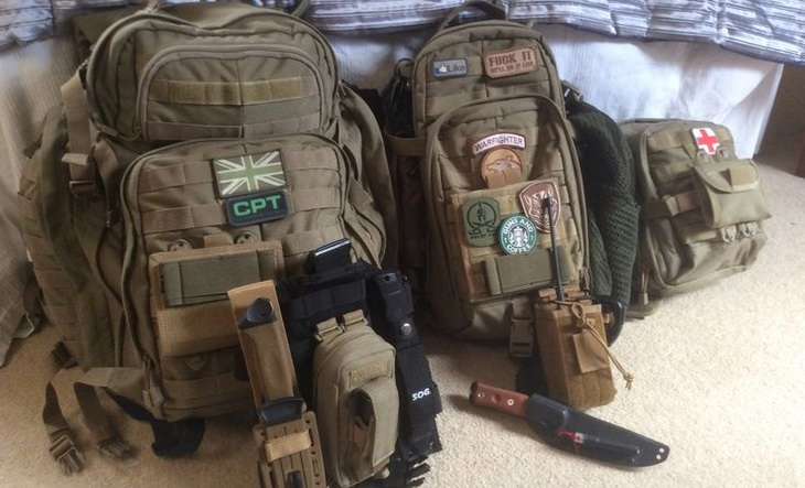 Bug out bag on the floor near a bed