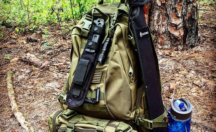 A bug out bag in the forest on the ground