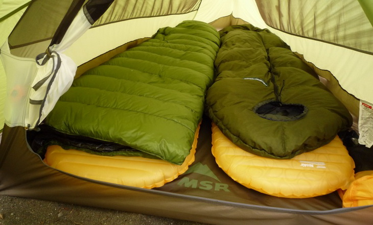 Backpacking sleeping bags in a tent