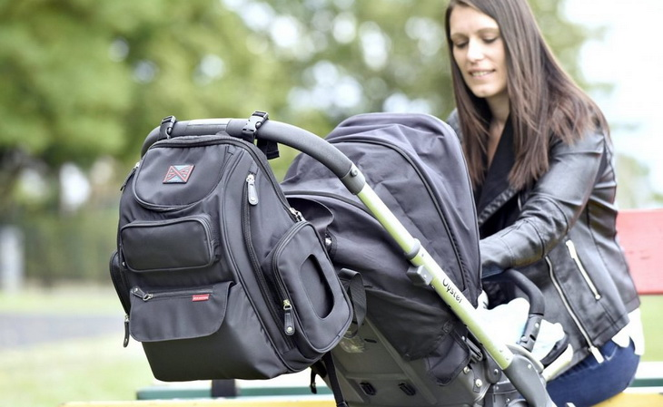 Image showing a Bag Nation Diaper Bag Backpack and a woman looking at her child