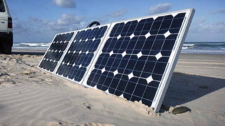 Camp4ever 150w Portable Solar Panel on a beach