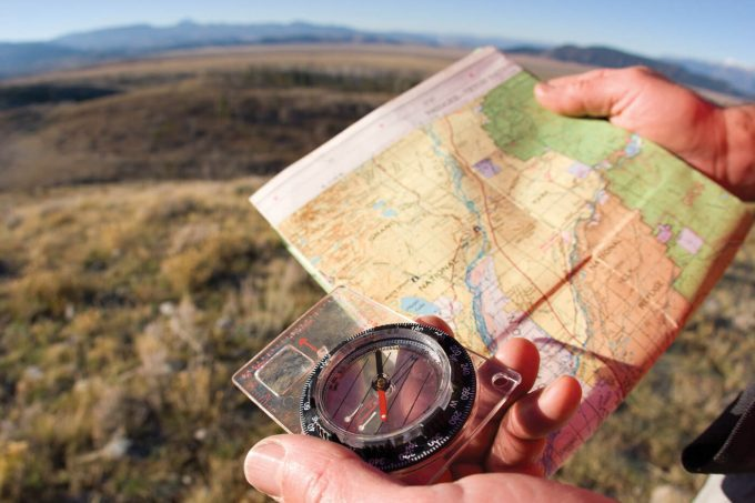 Compass-and-map-in-the-hands-of-man-680x453