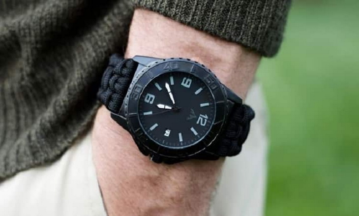 A man wearing a survival watch