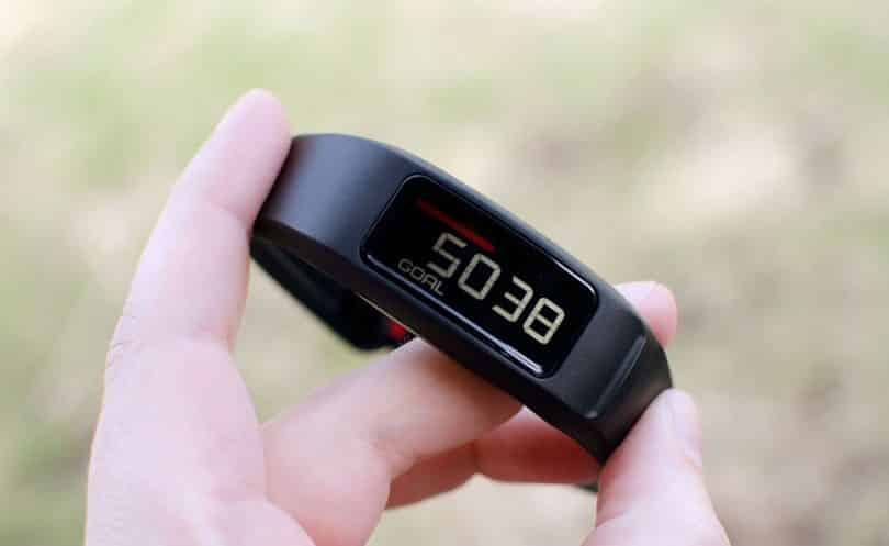 fitness tracker in hand