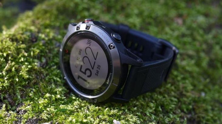GPS running watche on the grass