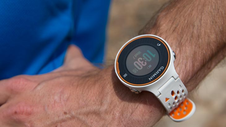 Garmin Forerunner 620 watch on a man's hand