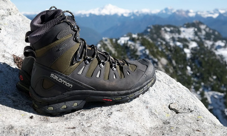 A pair of hiking boots and a mountains landscape