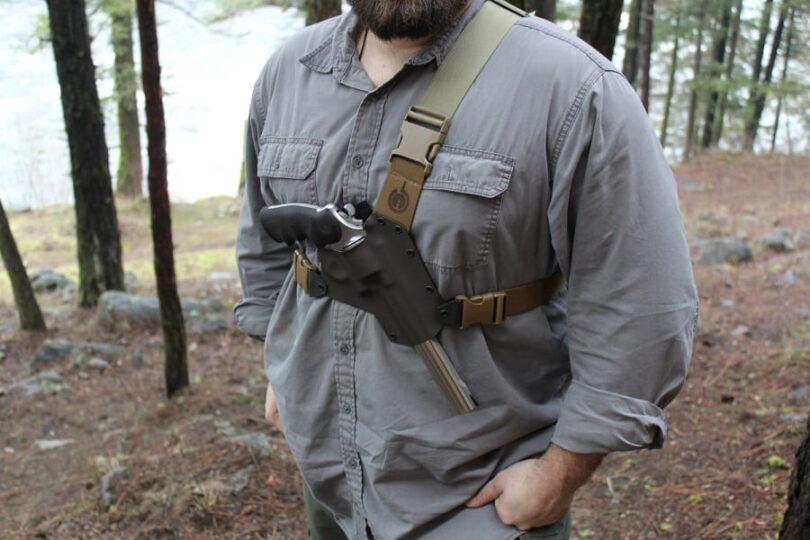 Man hiking with gun