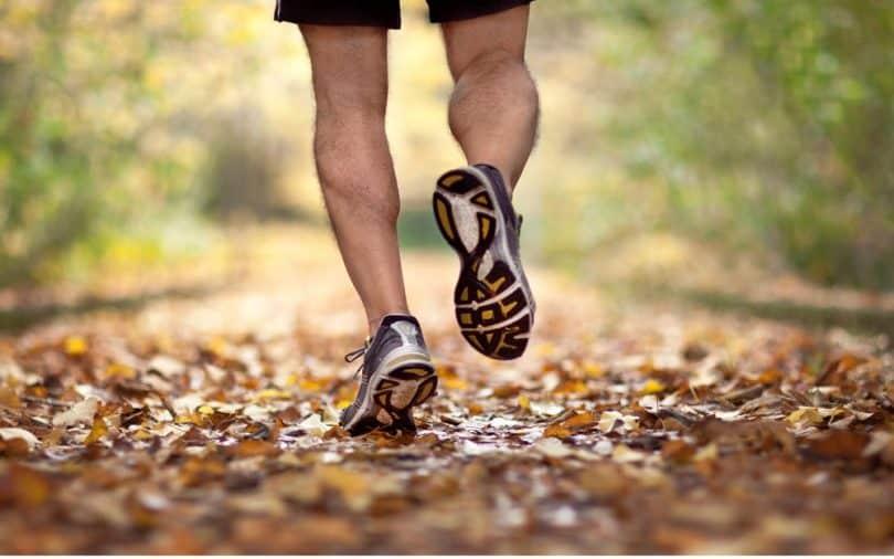 man on trail running