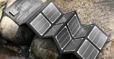 Waterproof Poweradd-40W-Solar-Charger near a water