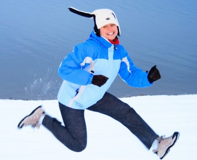 woman jumping on snow