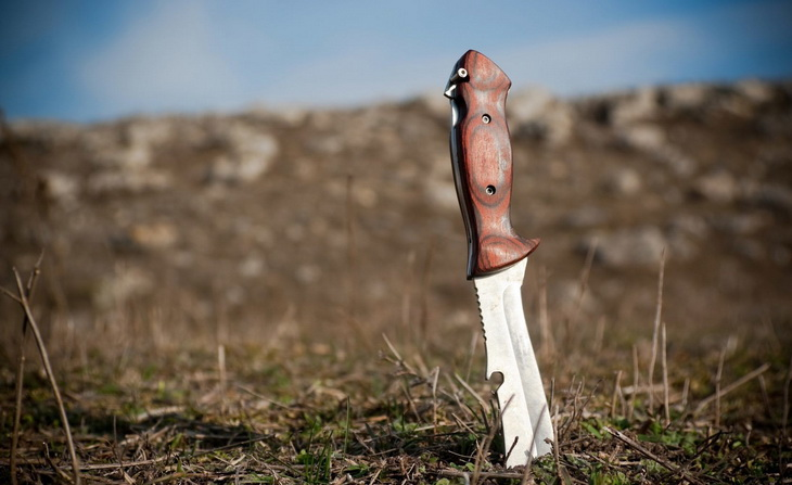 A survival knife in the ground