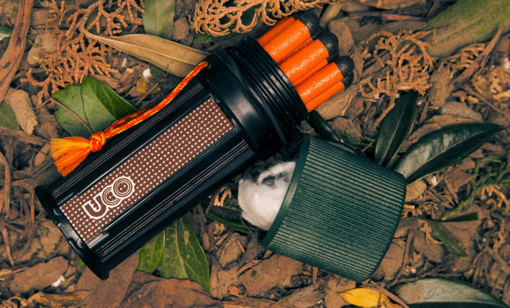 UCO Titan Stormproof Matches (Kit) laying on autumn leaves