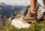 A woman wearing boots on a hilltop