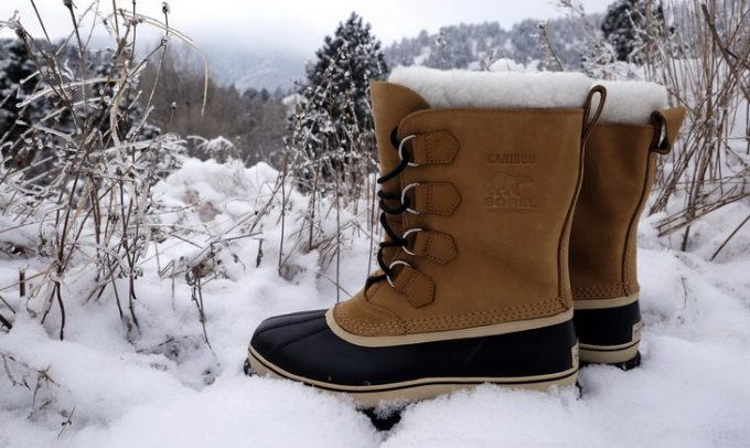 A pair of warm winter hiking boots in the snow