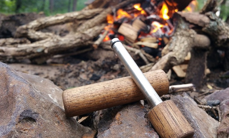 A Fire Starting Tool and a fire in the background