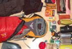 backpacking gear laid on floor