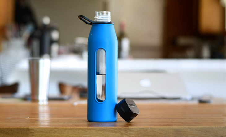 Blue water bottle on a wooden table in a house
