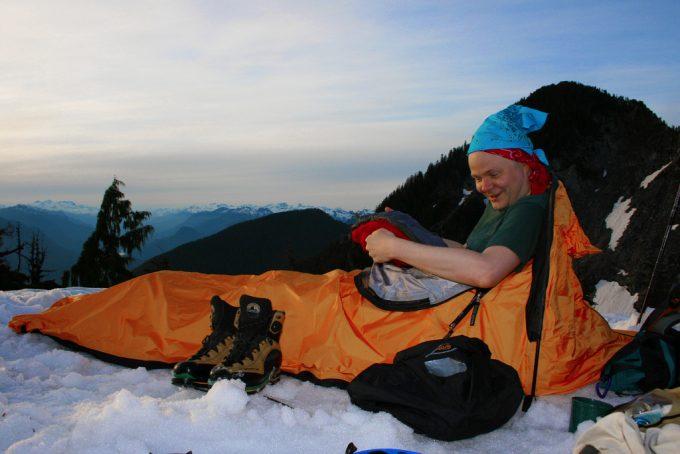 camper in winter sleeping bag