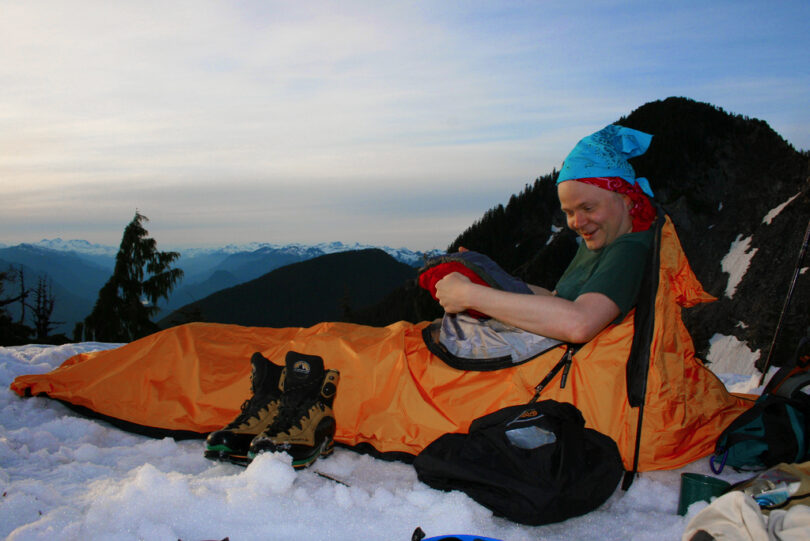 camper in winter sleeping bag