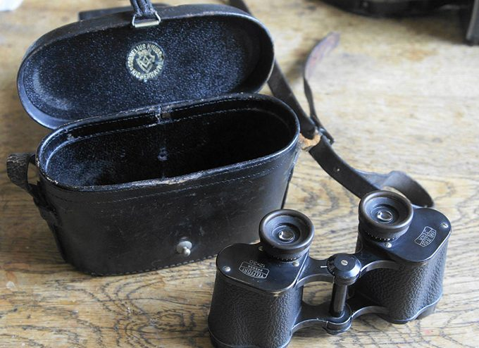 compact binoculars with housing on table