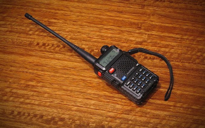 walkie talkie with a big antenna on desk