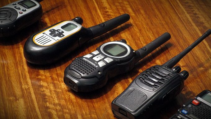 different types of walkies talkies on table