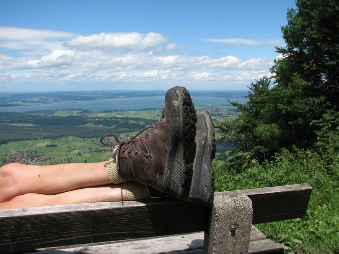 hiker resting his feet while wearing hiking shoes
