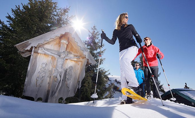 hikers with poles and snowshoes