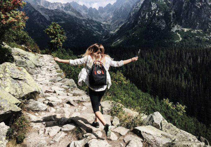 hiking girl in shirt running