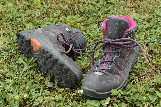 A pair of hiking shoes on the grass
