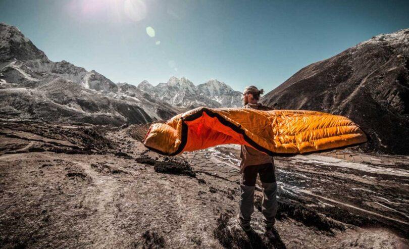 man holding lightweight sleeping bag