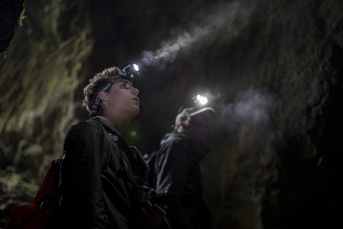 man with headlamp in cave