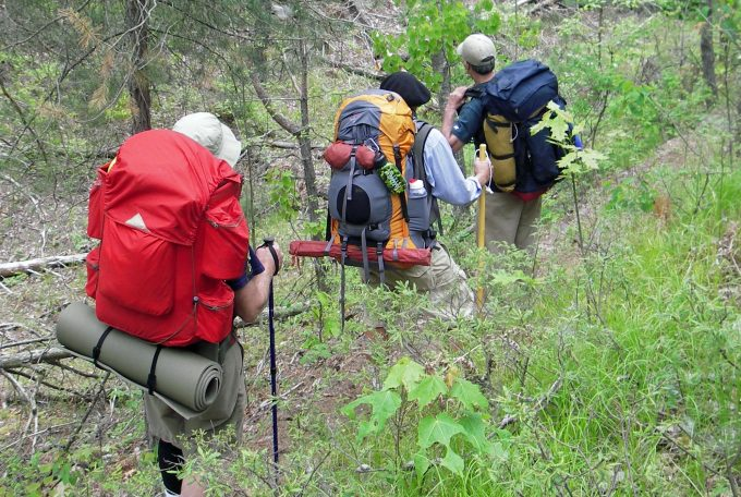 hikers with backpacks that have external frames