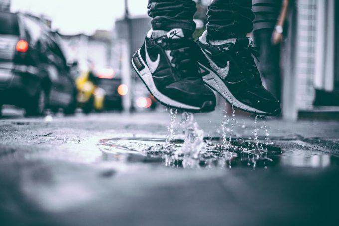 Man jumping in the air wearing nike sneakers
