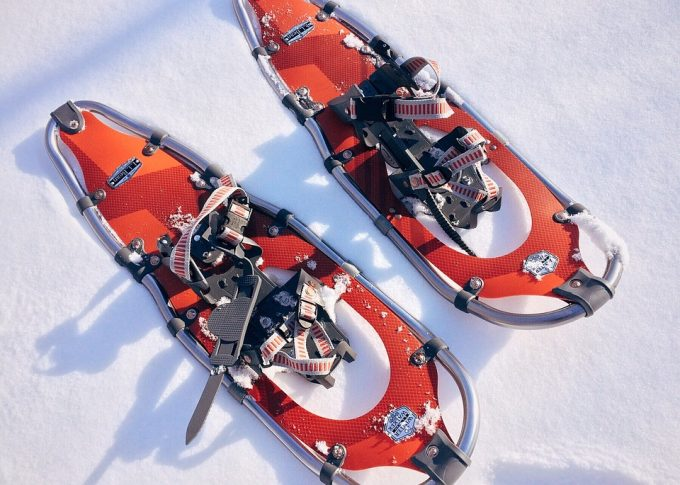 red snowshoes on snow
