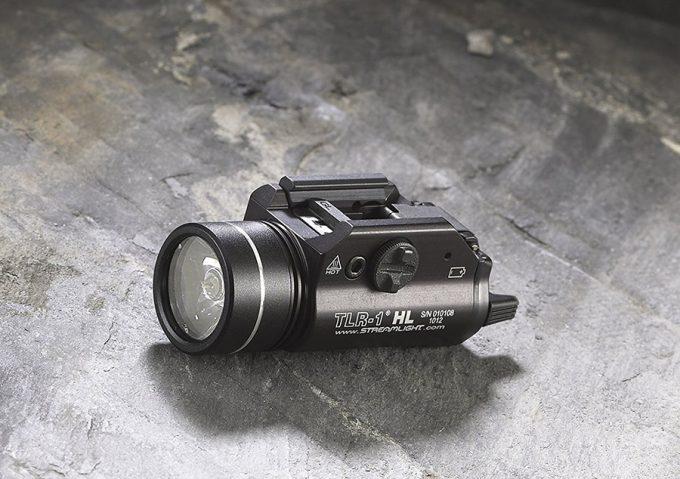 tactical flashlight on a rock