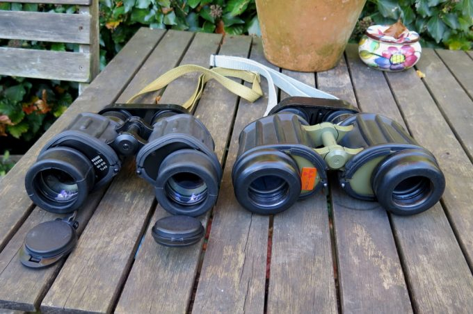 two sets of binoculars on table