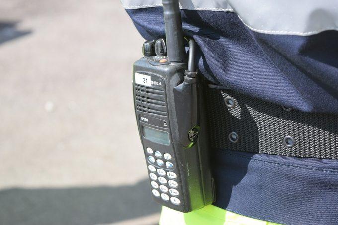 man wearing walkie talkie on belt